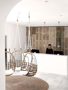 :: Havens South Designs :: loves the louvered back wall of the reception desk at San Giorgio Mykonos Hotel