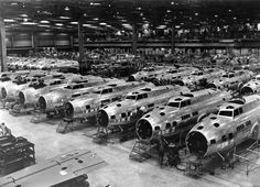 Boeing B-17Es under construction. This is the first released wartime production photograph of Flying Fortress heavy bombers at one of the Boeing plants, at Seattle, Wash. Boeing exceeded its accelerated delivery schedules by 70 percent for the month of December 1942. (U.S. Air Force photo)
