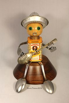 """Radford's Spicy Serenade"" ~ Found object, junk art created by Laurie Schnurer in 2016."