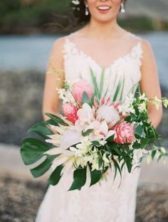 Bridal Bouquet with King Protea, Ginger, Orchids & Monstera Leaf Tropical Wedding Bouquets, Tropical Flower Arrangements, Wedding Flower Arrangements, Floral Wedding, Wedding Flowers, Wedding Dresses, Tropical Centerpieces, Tropical Weddings, Flower Centerpieces