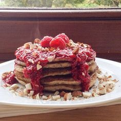 Dreaming of these pancakes my pal Kat @curlsnchard made  Topped with quick raspberry chia seed jam (recipe on www.breakfastcriminals.com). What are you guys up to this weekend? So many beautiful creations tagged #breakfastcriminals, love seeing them!