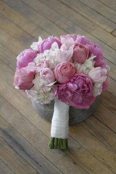 pink peonies, soft pink hydrangea, Romantic Antike Garden Roses, white cymbidium orchids, and pink tipped tulips