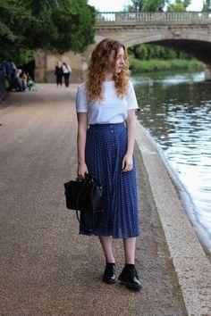 & Other Stories white tee & midi polka dot skirt and Doc Martens.