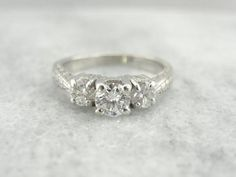 Lovely Engraved Platinum Three Stone Diamond Engagement Ring