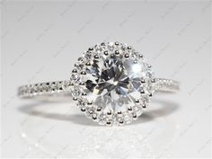 Platinum Halo Pave XE101 by Danhov Designer Engagement Ring with Round 1.22 Carat F VS1 Ideal Cut Diamond.