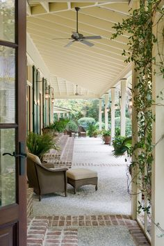 Comely West Indies home interior design Traditional Porch board and batten shutters brick steps Caribbean ceiling fan climbing plants exposed beams exposed rafters glass doors lowcountry planters square columns tabby terrace veranda west indies Pergola, Outdoor Rooms, Outdoor Living, Outdoor Seating, Historical Concepts, Traditional Porch, Casa Patio, British Colonial Style, Home Porch