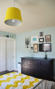 Using a frame collage to hide a TV in plain sight. #tv #television #decor #bedroom #diy