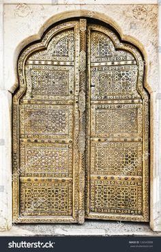 stock-photo-old-golden-doors-of-the-hawa-mahal-hawa-mahal-the-palace-of-winds-in-jaipur-rajasthan-india-126543008.jpg (1022×1600)