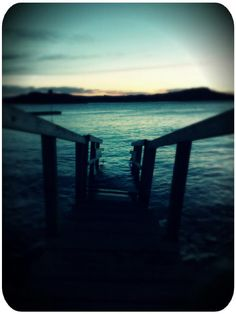 Mobile photo of a bridge being reclaimed by the sea near Marstrand.  Captured by Måns Viktorson.