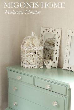 Beautiful makeover of a dark, plain dresser to a aqua art piece.