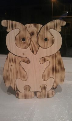 Uiltje puzzel van hout