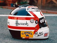 Nigel Mansell. Now theres a proper helmet design. Nigel changed it slightly year by year but always kept the basic design theme.