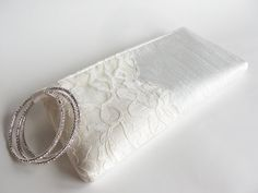 lacy clutch for the bride (by keepbags) have someone responsible for holding your necessities through out the day, gum, lip gloss, body spray