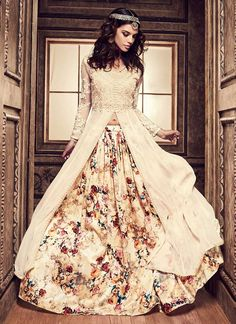 Buy Cream Umbrella Long Choli Lehenga online from the wide collection of umbrella-lehenga. This Cream colored umbrella-lehenga in Net   Faux Georgette fabric goes well with any occasion. Shop online Designer umbrella-lehenga from cbazaar at the lowest price.