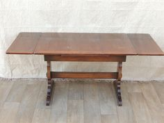 ERCOL Dining Table  (Size: 114cm-compact size; 175cm-W- when extended; 71cm-D; 74cm-H)  Made of so