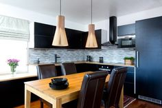 Secto 4201 pendants above a dining table in Espoo, Finland. Photo by Uzi Varon.