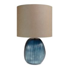 Create a natural feel in any room of the home with this stunning Patara table lamp from Guaxs. Made from luxurious mouth-blown glass, the base draws inspiration from the ocean in beautiful mottled ...