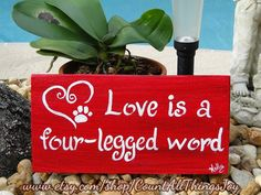Love Is A Four-Legged Word sign with paw print and heart.  Painted in the color of your choice by CountAllThingsJoy, $15.00