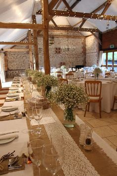 Rustic wedding table setting decor with lace, burlap and baby's breath