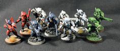 """I made a series of custom shoulder pads for Tau Fire Warriors in Warhammer These shoulder pads bear the specific emblem of different factions of Tau """"Septs"""" and are painted as such. Paint Schemes, Colour Schemes, Eldar 40k, Tau Warhammer, Fire Warrior, Tau Empire, Warhammer 40k Miniatures, Sword And Sorcery, Mini Paintings"""