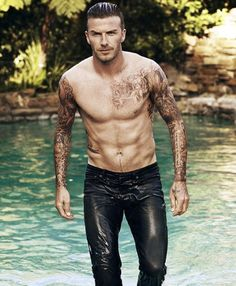 Soaking wet and emerging from a swimming pool, David Beckham graces Elle magazine's first solo male cover. Ohhh what I would do to you :)