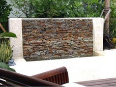 This stacked-stone water feature functions as an art piece that's visible from the patio, deck and even indoors.