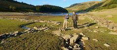 Mardale village revealed in Haweswater due to drop in reservoir levels over long, hot summer.