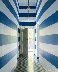 Cement tiles by Popham Design line the entryway; the walls are painted in a custom indigo.