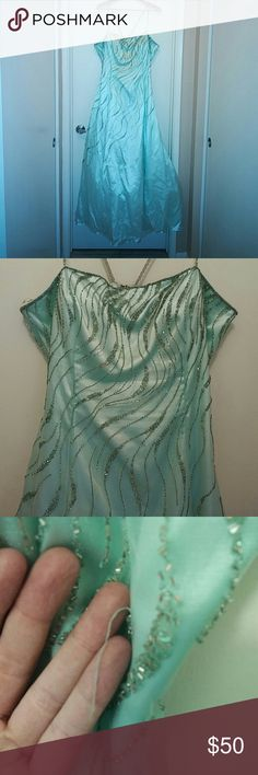 """Light Mint Beaded Prom Gown *Priced to sell! This was worn once, approx 15yrs old. Will need to be dry cleaned but is in very good condition! No stains or rips, some loose beads but nothing unfixable! See photos. Hook/eye closure, spaghetti straps. Size 20 prom is truly like 16/18 missy. Satin fabric with mesh headed overlay. Beading and sequins are all silver. Bust measures 21"""" flat with soft cups, and is 54"""" long from top of bust. Would clean up nicely for a formal event or make a great…"""