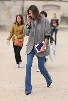 Oversized layers on top prove the perfect match for a slim-fitted flared jean.