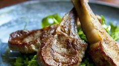 Minted peas with grilled lamb cutlets.
