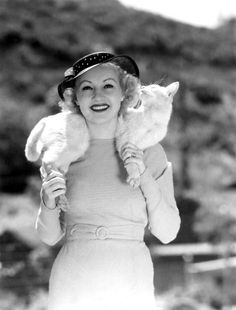 Betty Grable with her cat Whitney, 1935