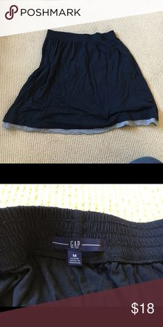 "Casual Gap jersey skirt This is a knee length knit navy skirt from the Gap. It has a faux-second layer of grey fabric to give it a layered effect. Has pockets and is super comfortable. Size small petite but I'm 5'11"" and I wore it all the time. GAP Skirts A-Line or Full"