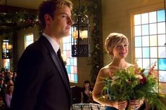 SMALLVILLE - CHLOE AND OLIVER STAND BESIDE THEIR FRIENDS...