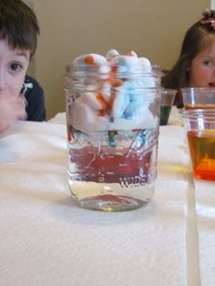 found this on teach preschool.  Water in a jar.  Make a cloud using shaving cream.  Add colored water (food coloring) using an eye dropper.  Wtchthe color work its way down the cloud.  Use after discussion of how the clouds gather water until it is full and then it rains.  The colored water is the rain.