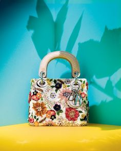 LES FLEURS: This Lady Dior is in bloom with rich embroidery and sequins. 212 872 2555