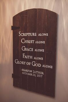 """http://onegirldesignshoppe.com/products/10486683-reformation-door Martin Luther's Reformation Door measures approximately 40""""X26"""". In dark stain with white text and black hinges, the door is $165."""