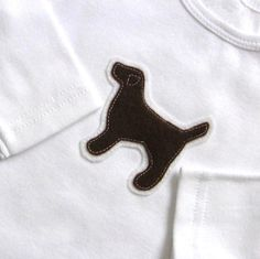 A short- or long-sleeve bodysuit for the littlest lab lover in your home.  Our lab-mix lover has one!