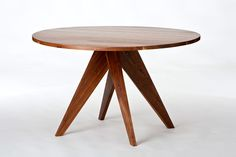 This round walnut dining table by Stylo Furniture & Design is available in several different diameters to accommodate up to 8 people. The top and legs are made of solid wood.  A durable, satin, waterproof finish offers the highest level of protection.