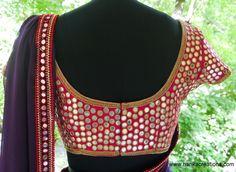 Mirror work on a saree blouse. Indian fashion.