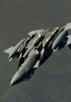 F-15E Strike Eagle barrel rolling away from its refueling aircraft.