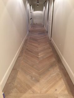 herringbone wooden floor in a hallway