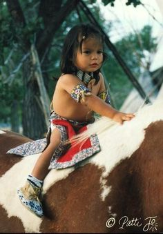Native American child on horse, beautiful...