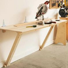 Fold Flat workbench ..this would be great for our yearly Christmas gatherings we have in the garage ...