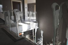 This frameless balustrade design was created using etching combined with bonded glass crystals.