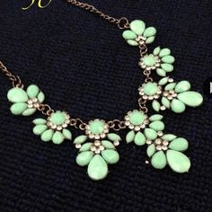 Mint Resin Tear Drops Flowers Statement Necklace A pop of color kind of statement necklace.  It features tear drops mint resin, small acrylic crystals, dark silver adjustable chain, NWOT, and comes with dust bag Jewelry Necklaces