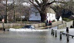 UK WEATHER: Cornish daredevils grab their boards to ride flooded ...