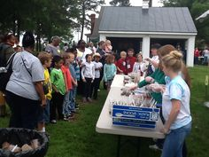 Second graders from Surry Elementary and Isle of Wight schools attend the Peanut Soil and Water Conservation District Farm Day.  At this stations, they learn the layers of soil through a tasty edible snack: 1-Bedrock (broken vanilla waffers), 2- Subsoil (chocolate pudding), 3-Topsoil (crunched Oreo cookies), 4-Decomposers (gummy worms), 5-Organic Matter (sprinkles). All nicely put in a small cup and the youth enjoy eating their layers of soil!