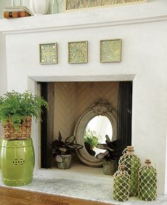 I like the idea of reflecting light from my dark, non working fireplace with a mirror.  From StyleStudio.