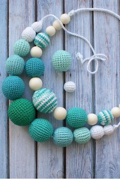 Natural wooden bright blue crochet teething necklace in boho style